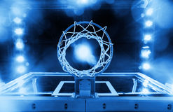 Basketball Hoop in a sports arena (blue toned) stock image