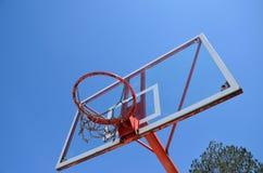 Basketball hoop and tree Royalty Free Stock Photos