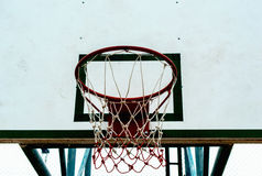 Basketball hoop on white background. Basketball hoop as viewed from below against a bright blue sky Stock Photo