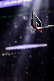 Basketball houp in light shine in bokeh background Royalty Free Stock Photo