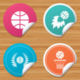 Basketball icons. Ball with basket and fireball. Round stickers or website banners. Basketball sport icons. Ball with basket and fireball signs. Laurel wreath Royalty Free Stock Photos