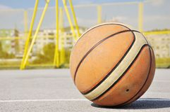 Basketball iluminating by sunlight Royalty Free Stock Image
