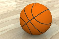 Basketball. Isolated ball basketball on wooden floor Stock Photos
