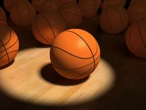 Basketball items. Basketball  ball over the hardwood floor by spot lighting (3D Stock Photography