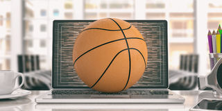 Basketball on a laptop - office background. 3d illustration. Basketball ball on a laptop - office background. 3d illustration Royalty Free Stock Photo