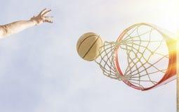 Basketball Layup. Shot scene from just below the net Stock Image
