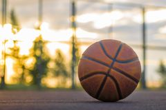 Basketball ball lies on the ground against the background of the stock photography