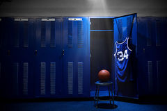 Basketball Locker Room. An open locker with a jersey and ball in a authentic basketball locker room. Lots of Copy Space Stock Images