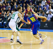 Basketball match. BARCELONA - MARCH 24: Jaka Lakovic (R) of Barcelona in action during the Euroleague basketball match between FC Barcelona and Panathinaikos Royalty Free Stock Image