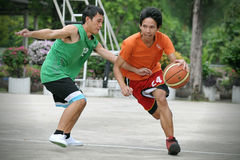Basketball Match. Unidentified men compete in an informal basketball meet at a public court in Lumpini Park on September, 10, 2012 in Bangkok, Thailand Stock Images