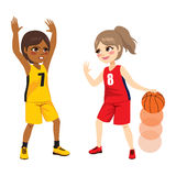 Basketball Match. Two young female girls playing on basketball match Royalty Free Stock Photography