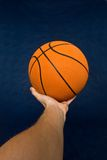 Basketball in mens hand Stock Photography