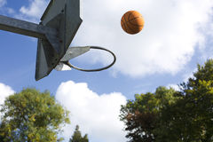 Basketball in mid air Royalty Free Stock Image