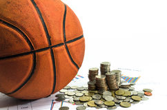 Basketball and money coins on white background Royalty Free Stock Image