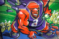 Basketball monster graffiti. Colorful graffiti of monster playing basketball on the street Royalty Free Stock Images