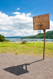 Basketball net. A makeshift basketball net overlooking a scenic view of lake Taal, Philippines Royalty Free Stock Photography