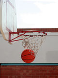 Basketball and Net. A basketball goes through the net Stock Images
