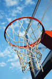 Basketball net. Close up view of a basketball net against the blue sky Stock Photography