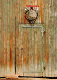 Basketball net on ancient door. An basketball net hanging over an ancient door at a farm Royalty Free Stock Photography