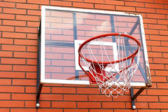 Basketball net on the brick wall. View of basketball net on the brick wall Royalty Free Stock Photo