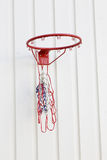 Basketball net. A broken basketball net mounted on light grey painted wooden wall Stock Image