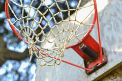 Basketball Net Close Up. Close up of basketball net on wooden backboard in backyard Royalty Free Stock Photography