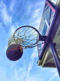 Basketball In The Net Royalty Free Stock Image
