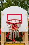 Basketball net and hoop. Attached to a backboard at a playground Stock Photo