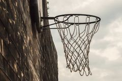 Basketball net on a street wooden wall on a sky background close Royalty Free Stock Photos