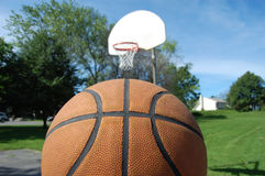 Basketball and Net on Sunny Day Stock Photography