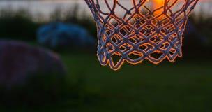 Basketball net  sunset light Royalty Free Stock Photo