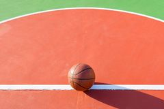 Basketball on an outdoor playing field. In a day time Royalty Free Stock Photo