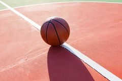 Basketball on an outdoor playing field. In a day time Stock Photography