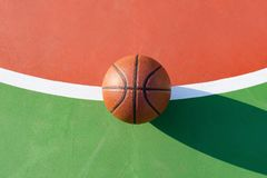 Basketball on  an outdoor playing field. In a day time Royalty Free Stock Photos