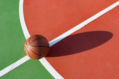 Basketball on an outdoor playing field. In a day time Stock Image