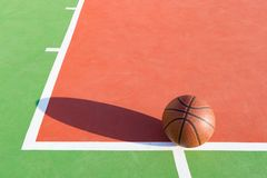 Basketball on an outdoor playing field. In a day time Stock Photo