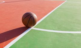 Basketball on an outdoor playing field. In a day time Royalty Free Stock Image