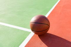 Basketball on an outdoor playing field in a day time. Close up Stock Photos