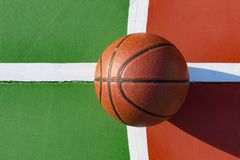 Basketball on an outdoor playing field in a day time. Close up Royalty Free Stock Photography