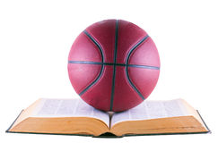 Basketball over book Royalty Free Stock Images