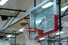 Basketball over the rim indoors stock image
