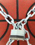 Basketball with Padlock And Chain Royalty Free Stock Photos