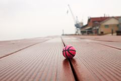 Basketball on the panels in the harbor royalty free stock photos
