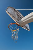 Basketball Park. Basketball net at park under bright blue sky Stock Image