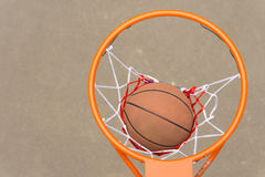 Basketball passing through the hoop and net Royalty Free Stock Photo
