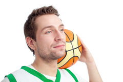 Basketball player. Standing with ball behind his head looking up Stock Photos