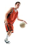 Basketball player. Dribbling the ball Stock Photos