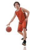 Basketball player. Dribbling a ball Stock Photography