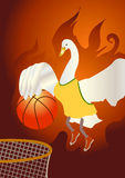 Basketball player. A swan which is on fire jump up and shoot a basketball in to the hoop Royalty Free Stock Photo