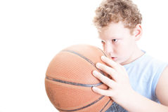 Basketball player. Boy with a basketball on a white background Stock Photography